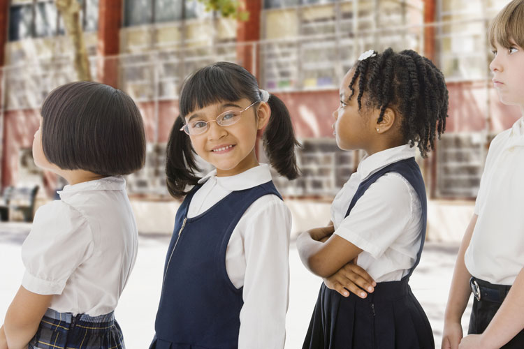 bigstock-School-children-in-uniforms-in-48319247
