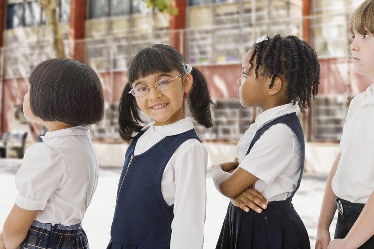 bigstock-School-children-in-uniforms-in-48319247