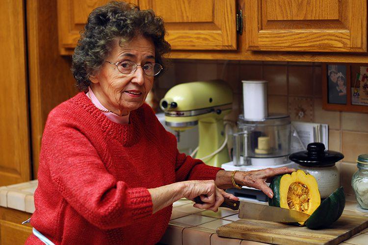 bigstock-Grandmother-Cuts-Vegetables-1166399